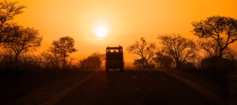 Safari vehicle at sunset Kruger, leopard travel